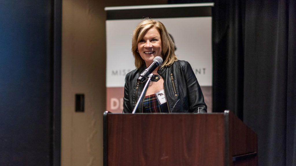 Executive Vice President Monica Swoboda highlights JES' fundraising successes at the 2018 Employee Recognition Ceremony.